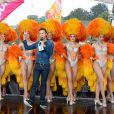 Cyril Féraud sur le départ de la deuxième étape de la 103ème édition de la course cycliste du tour de France avec les danseuses du Moulin-Rouge le 3 juillet 2016 entre Saint-Lo et Cherbourg-en-Cotentin, en Normandie le 3 juillet 2016. . © Coadic Guirec / Bestimage