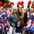 Michel Polnareff, sa compagne Danyellah et leur fils Louka - Le chanteur français Michel Polnareff fête son 72ème anniversaire en présence des danseuses du Moulin-Rouge et donne le départ de la deuxième étape de la 103ème édition de la course cycliste du tour de France le 3 Juillet 2016, entre Saint-Lo et Cherbourg-en-Cotentin, en Normandie. © Coadic Guirec / Bestimage