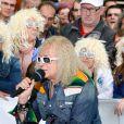 Michel Polnareff - Le chanteur français Michel Polnareff fête son 72ème anniversaire en présence des danseuses du Moulin-Rouge et donne le départ de la deuxième étape de la 103ème édition de la course cycliste du tour de France le 3 Juillet 2016, entre Saint-Lo et Cherbourg-en-Cotentin, en Normandie. © Coadic Guirec / Bestimage
