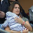 Amélie Mauresmo et son fils Aaron lors du match du quart de finale de l'UEFA Euro 2016 France-Islande au Stade de France à Saint-Denis, France le 3 juillet 2016. L'ex-championne de tennis a retrouvé la compagnie de Yannick Noah dans les gradins. © Cyril Moreau/Bestimage