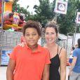 Sandrine Diouf et son fils Isaac - Inauguration de la Fête des Tuileries à Paris le 26 juin 2015.