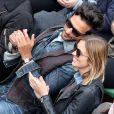 Maxim Nucci (Yodelice) et sa compagne Isabelle Ithurburu dans les tribunes des Internationaux de France de tennis de Roland-Garros à Paris. Le 24 mai 2016 © Dominique Jacovides / Bestimage