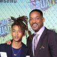 """Jaden Smith et ses dents en or avec son père Will Smith - Premiere du film """"Suicide Squad"""" à New York le 1er aout 2016."""