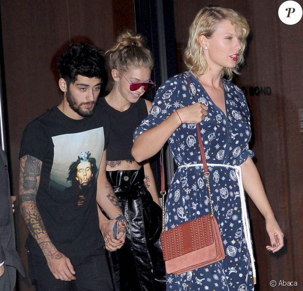 Taylor Swift à la sortie de l'appartement Gigi Hadid à New York. Gigi Hadid est avec son compagnon, le chanteur Zayn Malik. Le 12 septembre 2016