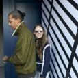 """Le chanteur Stromae, les cheveux longs, et sa femme Coralie Barbier quittent leur hôtel pour se rendre au défilé de mode """"Louis Vuitton"""" collection prêt-à-porter printemps-été 2017 lors de la Fashion Week, place Vendôme à Paris, France, le 5 octobre 2016. © Agence/Bestimage"""