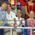 Bill, Melinda Gates et leurs deux filles - Bassin olympique à Pékin, en Chine, le 10 août 2008