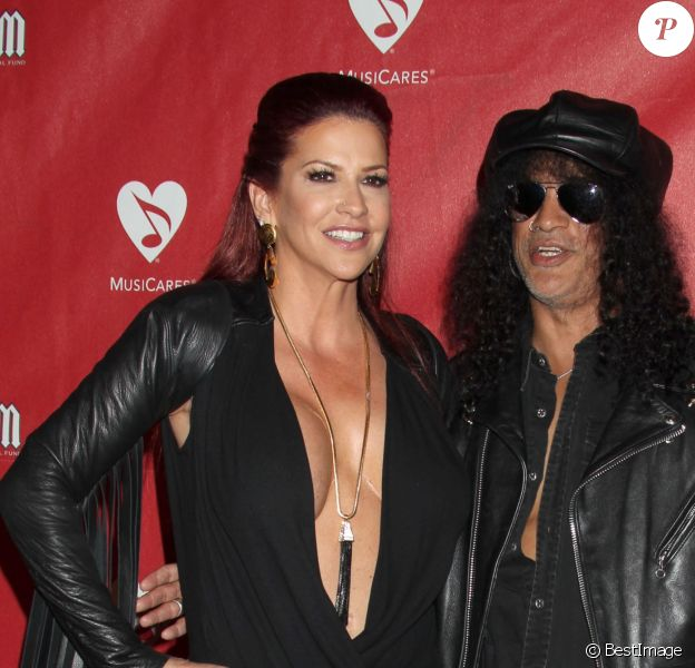 "Perla Hudson, Slash - People au concert ""MusiCares MAP"" à Los Angeles, le 13 mai 2014.  Celebrities arrive at the 2014 MusiCares MAP Fund Benefit Concert at Club Nokia on May 12, 2014 in Los Angeles, California.13/05/2014 - Los Angeles"