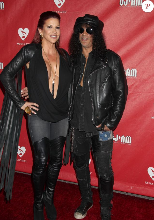 """Perla Hudson, Slash - People au concert """"MusiCares MAP"""" à Los Angeles, le 13 mai 2014.  Celebrities arrive at the 2014 MusiCares MAP Fund Benefit Concert at Club Nokia on May 12, 2014 in Los Angeles, California.13/05/2014 - Los Angeles"""