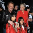 Johnny Hallyday, sa femme Laeticia et leurs filles Jade et Joy au vernissage de l'exposition du photographe Mathieu Cesar à Los Angeles. Le 21 février 2017