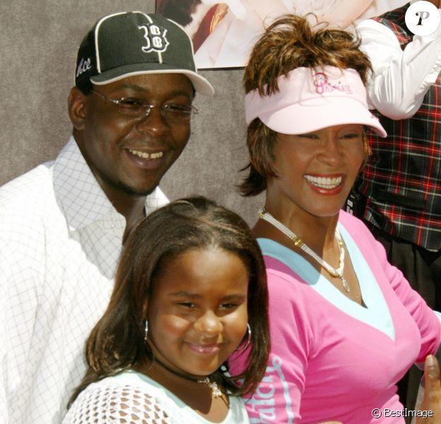 Whitney Houston et Bobby Brown avec leur fille Bobbi Kristina à Los Angeles, le 8 août 2004