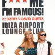 """David et Cathy Guetta inaugurent le """"F*** Me I'm Famous Lounge Club"""" à l'aéroport d'Ibia, le 17 juillet 2012."""