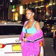 Rihanna porte un jogging rose fluo à son arrivée au défilé Fenty Puma by Rihanna lors de la Fashion Week à New York, le 10 septembre 2017.