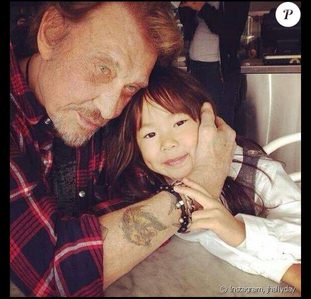 Johnny Hallyday avec sa fille Joy sur Instagram, le 27 juillet 2014.