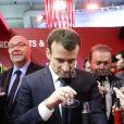 Le président de la république francaise, Emmanuel Macron accompagné de Stéphane Travert rencontre la filière des vins durant sa visite au salon de l'agriculture, Paris, France le 24 février 2018. © Stéphane Lemouton / Bestimage