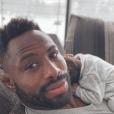 Fulgence Ouedraogo prend la pose avec son fils, né de sa relation avec Ariane Brodier. Le 28 février 2018.
