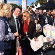 Dominique Serra (l'organisatrice du Rallye Aicha des Gazelles), Christian Estrosi, le maire de Nice, et sa femme Laura Tenoudji avec leur fille Bianca - Départ du 28ème Rallye Aicha des Gazelles depuis la Promenade des Anglais à Nice le 17 mars 2018. © Bruno Bebert/Bestimage