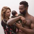 Fulgence Ouedraogo et Ariane Brodier posent avec leurs fils d'un mois. Février 2018.