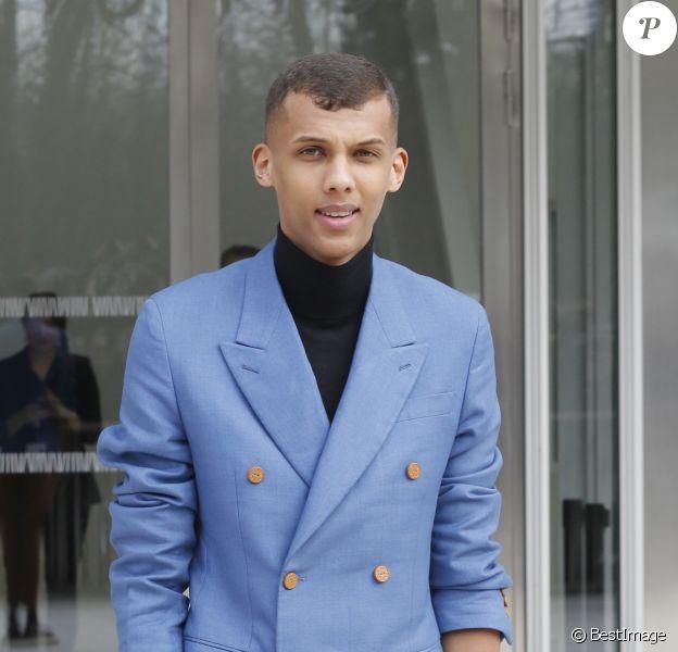 """Stromae - People à la sortie du défilé de mode """"Louis Vuitton"""", collection prêt-à-porter automne-hiver 2015/2016, à Paris. Le 11 mars 2015."""