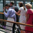 La duchesse Catherine de Cambridge (Kate Middleton) et la duchesse Meghan de Sussex (Meghan Markle) arrivant à Wimbledon le 14 juillet 2018, quelques dizaines de minutes avant le début de la finale dames opposant Serena Williams et Angelique Kerber.