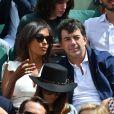 Stéphane Plaza et Karine Le Marchand assistent au tournoi de Roland-Garros, le 5 juin 2017 à Paris.