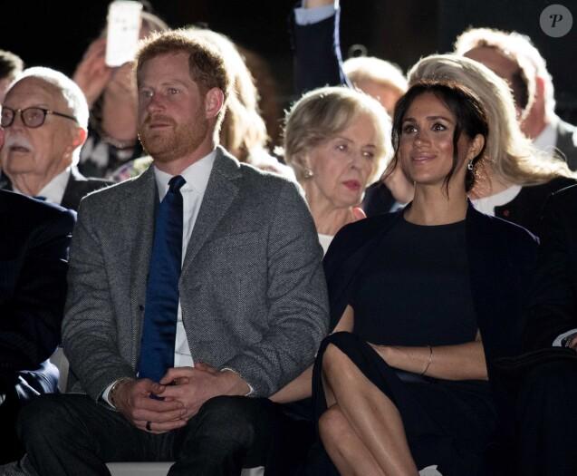 """Le prince Harry, duc de Sussex, et Meghan Markle, duchesse de Sussex, enceinte, assistent à la cérémonie d'ouverture des """"Invictus Games 2018"""" à Sydney, le 20 octobre 2018."""