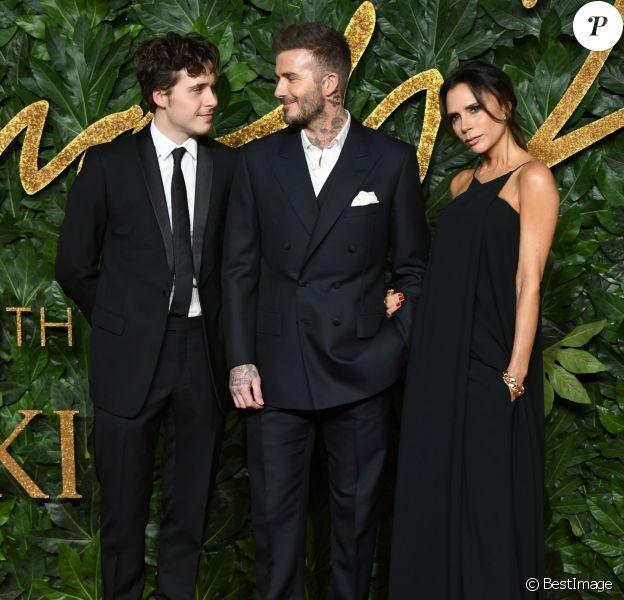 Brooklyn Beckham et ses parents David Beckham et Victoria Beckham assistent aux Fashion Awards 2018 au Royal Albert Hall à Londres, le 10 décembre 2018.