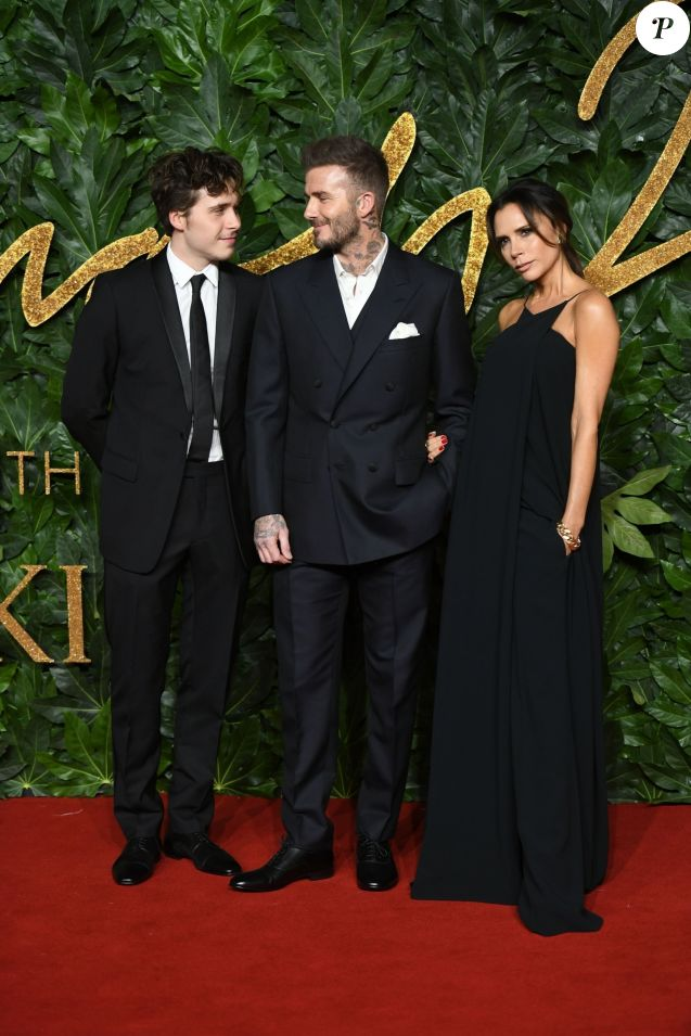 Brooklyn Beckham et ses parents David Beckham et Victoria Beckham assistent aux Fashion Awards 2018 au Royal Albert Hall à Londres, le 10 décembre 2018.