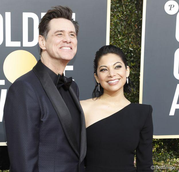 Jim Carrey et sa compagne Ginger Gonzaga au photocall de la 76ème cérémonie annuelle des Golden Globe Awards au Beverly Hilton Hotel à Los Angeles, Californie, Etats-Unis, le 6 janver 2019.