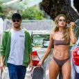 Exclusif - Doutzen Kroes fait du skateboard en bikini lors d'une séance photo sous l'oeil de son mari Sunnery James. Miami, le 28 mars 2019.