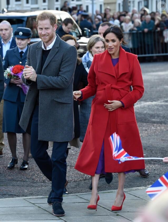 Le prince Harry, duc de Sussex, et Meghan Markle, duchesse de sussex, enceinte, lors d'une visite à Birkenhead le 14 janvier 2019.