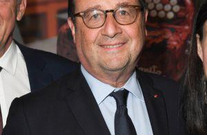 François Hollande : Sac girly à la main lors de sa visite aux puces