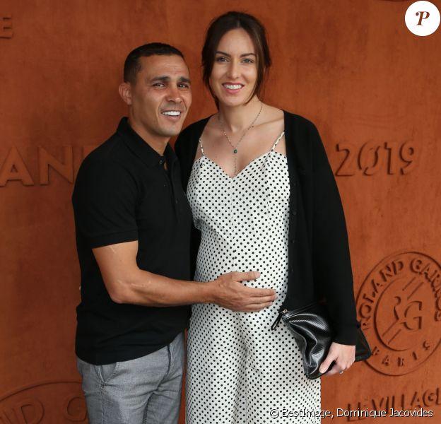 Brahim Asloum et sa compagne (enceinte) au village lors des internationaux de tennis de Roland Garros à Paris le 27 mai 2019. © Dominique Jacovides / Bestimage