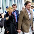 Delphine Boël, son mari Jim O' Hare et son avocat quittent le tribunal à Bruxelles, le 2 octobre 2014. Delphine Boël intente une double action judiciaire en contestation de paternité à l'égard de Jacques Boël et en recherche de paternité à l'égard du roi Albert II de Belgique.