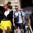 Céline Dion quitte l'hôtel Crillon, vêtue d'une veste et d'une jupe Ronald Van Der Kemp et chaussée en Jimmy Choo. Paris, le 30 juin 2019.