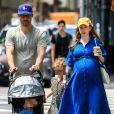 Exclusif - Chelsea Clinton enceinte et son mari Marc Mezvinsky se promènent avec leurs enfants Charlotte et Aidan à New York, le 15 juillet 2019