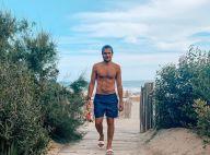 Amir : Le jeune papa affiche ses abdos de rêve à la plage