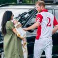 Le prince Harry, duc de Sussex, Meghan Markle, duchesse de Sussex, et leur fils Archie Mountbatten-Windsor lors d'un match de polo de bienfaisance à Wokinghan le 10 juillet 2019.