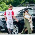 Le prince Harry, duc de Sussex, Meghan Markle (en robe Lisa Marie Fernandez) et leur fils Archie Harrison Mountbatten-Windsor lors d'un match de polo de bienfaisance King Power Royal Charity Polo Day à Wokinghan, comté de Berkshire, Royaume Uni, le 10 juillet 2019.