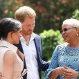 Meghan Markle, duchesse de Sussex, et le prince Harry, duc de Sussex, reçus par Graça Machel, veuve de N.Mandela, à Johannesburg. Le 2 octobre 2019