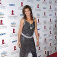 Cindy Crawford lors d'une soirée de bienfaisance, le 15 septembre 2006 à L.A ! Le jean slim sous une robe bling-bling, ça ne le fait pas trop !