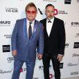 """Elton John avec son mari David Furnish lors de la soirée """"Elton John AIDS Foundation Oscar Party"""" à West Hollywood, le 22 février 2015."""