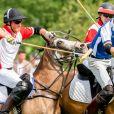 Le prince Harry et le prince William lors d'un match de polo de bienfaisance à Wokinghan, dans le Berkshire, le 10 juillet 2019.