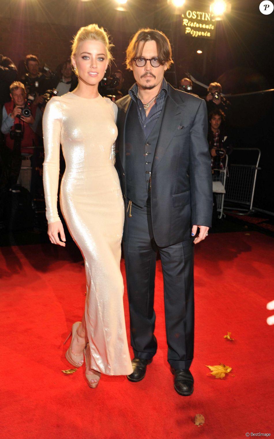 Amber Heard et Johnny Depp à l'Odeon Kensington de Londres pour la première britaannique du film The Rum Diary, le 3 novembre 2011.