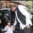 Johnny Hallyday avc sa fille Jade au cours du baptême de Joy à Gstaad en Suisse le 5 juillet 2009