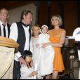 Johnny et Laeticia Hallyday avec leurs filles Jade et Joy au cours du baptême de cette dernière à Gstaad en Suisse le 5 juillet 2009 ainsi que le parrain Jean-Claude Darmon et la marraine Hélène Darroze
