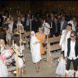Johnny et Laeticia Hallyday avec leurs filles Jade et Joy au cours du baptême de cette dernière à Gstaad en Suisse le 5 juillet 2009 ici dans l'église avec tous les convives