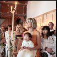 Laeticia Hallyday avec ses filles Jade et Joy au cours du baptême de cette dernière à Gstaad en Suisse le 5 juillet 2009