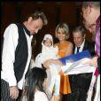 Johnny et Laeticia Hallyday avec le parrain Jean-Claude Darmon et leurs filles Jade et Joy au cours du baptême de cette dernière à Gstaad en Suisse le 5 juillet 2009