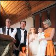 Johnny et Laeticia Hallyday avec leurs filles Jade et Joy au cours du baptême de cette dernière à Gstaad en Suisse le 5 juillet 2009, ici avec le parrain Jean-Claude Darmon et la marraine Hélène Darroze