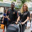 Exclusif - Maria Salaues la compagne de Paul Pogba et leur fils sur la 5ème Avenue à New York, le 2 juillet 2019.